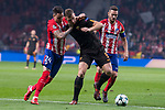 Atletico de Madrid Jose Maria Gimenez and Roma Edin Dzeko during UEFA Champions League match between Atletico de Madrid and Roma at Wanda Metropolitano in Madrid, Spain. November 22, 2017. (ALTERPHOTOS/Borja B.Hojas)