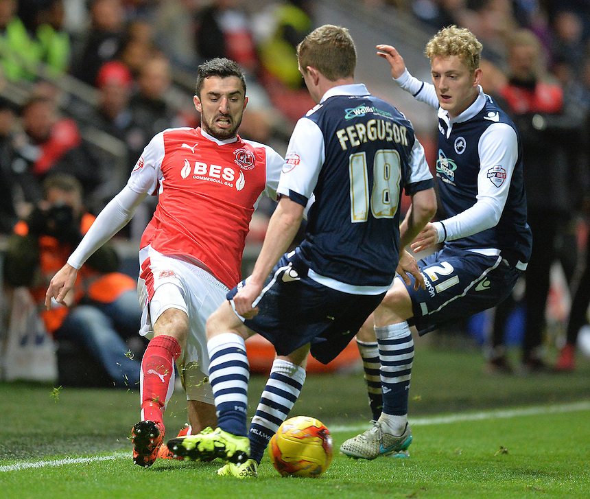Fleetwood Town's Conor McLaughlin gets the ball past Millwall's Shane Ferguson<br /> <br /> Photographer Dave Howarth/CameraSport<br /> <br /> Football - The Football League Sky Bet League One - Fleetwood Town v Millwall - Tuesday 24th November 2015 - Highbury Stadium<br /> <br /> &copy; CameraSport - 43 Linden Ave. Countesthorpe. Leicester. England. LE8 5PG - Tel: +44 (0) 116 277 4147 - admin@camerasport.com - www.camerasport.com