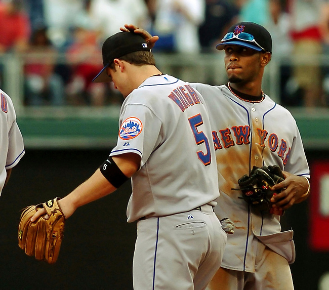 New York Mets David Wright, left, gets a tap on the head from teammate Jose Reyes, right,  as they celebrate the 5-4 victory over the Philadelphia Phillies in a MLB game Thursday, June, 15, 2006 in Philadelphia. NEWSDAY/Bradley C Bower)