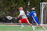 Orange, CA 03-05-17 - Daniel Aguilar (Chapman #41) and Michael Ellsworth (UCLA #34) in action during the UCLA - Champman Southern Lacrosse Conference MCLA Division 1 Men's Lacrosse game.