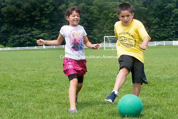 MIDDLEBURY CT. 06 July 2015-070615SV04-From left, Lauren Anderson, 8, of Middlebury passes to Chase D&rsquo;Augostino, 8, of Middlebury as he tries to score a goal while playing soccer at playground camp sponsored by Park and Recreation in Meadowview Park in Middlebury Monday.<br /> Steven Valenti Republican-American