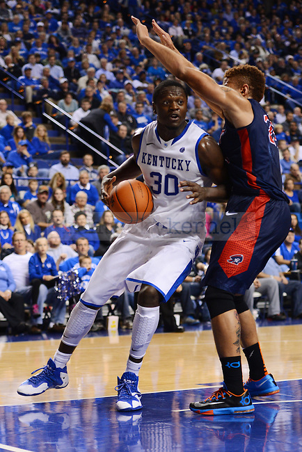 Kentucky Wildcats forward Julius Randle (30) tries to spin around Robert Morris Colonials forward Aaron Tate (24) during the second half of the UK men's basketball game vs. Robert Moriss in Rupp arena Lexington, Ky., on Sunday, November 17, 2013. UK beat Robert Morris 87 - 49. Photo by Eleanor Hasken | Staff