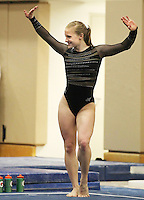 STANFORD, CA--March 1, 2013--Nicole Dayton with Stanford women's Gymnastics team competes on the bars during the competition against Cal and Oregon State University on the Stanford University Campus. Stanford won the competition .  Nicole Dayton