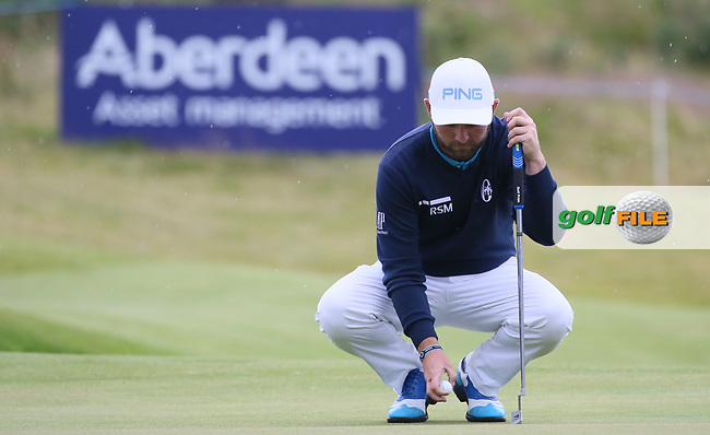 Andy Sullivan (ENG) plays into the burn at the 18th during Round Two of the Aberdeen Asset Management Scottish Open 2017, played at Dundonald Links, Troon, Ayrshire, Scotland.  14/07/2017. Picture: David Lloyd | Golffile.<br /> <br /> Images must display mandatory copyright credit - (Copyright: David Lloyd | Golffile).