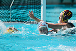 LOS ANGELES, CA - MAY 13: Hayley McKelvey #9 of the University of Southern California makes contact with Mackenzie Wiley #3 of Stanford University as Wiley reaches for the ball during the Division I Women's Water Polo Championship held at the Uytengsu Aquatics Center on the USC campus on May 13, 2018 in Los Angeles, California. USC defeated Stanford 5-4. (Photo by Tim Nwachukwu/NCAA Photos via Getty Images)