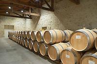 Oak barrel aging and fermentation cellar. Chateau Clos Fourtet, Saint Emilion, Bordeaux, France