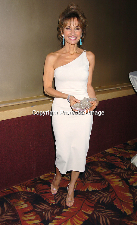Susan Lucci ..at the All My Children Christmas party at the Copacabana  on December 17, 2003. Photo by Robin Platzer, Twin Images.