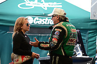 Jan. 16, 2013; Jupiter, FL, USA: NHRA funny car driver John Force (right) talks to daughter Brittany Force during testing at the PRO Winter Warmup at Palm Beach International Raceway.  Mandatory Credit: Mark J. Rebilas-