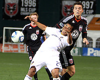 Mark Burch (4) of D.C. United in action with Miguel Lopez (25) of the Los Angeles Galaxy during an MLS match at RFK Stadium, on April 9 2011, in Washington D.C.The game ended in a 1-1 tie.