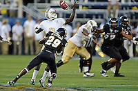 17 September 2011:  FIU defensive back Tevin Blanchard (29) forces a fumble by UCF quarterback Jeff Godfrey (2) that resulted in a touchdown for the FIU at the end of the first half as the FIU Golden Panthers defeated the University of Central Florida Golden Knights, 17-10, at FIU Stadium in Miami, Florida.