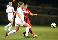 BOYDS, MARYLAND - April 06, 2013:  Hayley Siegel (17) of The Washington Spirit gets the ball away from Campbell Millar (20) of the University of Virginia women's soccer team in a NWSL (National Women's Soccer League) pre season exhibition game at Maryland Soccerplex in Boyds, Maryland on April 06. Virginia won 6-3.