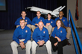 Houston, TX - July 11, 2007 -- Seven astronauts pause for an informal crew portrait at the conclusion a STS-118 pre-flight press briefing at the Johnson Space Center in Houston, Texas on July 11, 2007. Pictured from the left (front) are Canadian Space Agency astronaut Dafydd R. (Dave) Williams, mission specialist; Scott J. Kelly, commander; and Tracy E. Caldwell, mission specialist. Back row, left to right, are Charles O. Hobaugh, pilot; along with Richard A. (Rick) Mastracchio, Barbara R. Morgan and Alvin Drew Jr., all mission specialists.Credit: NASA via CNP