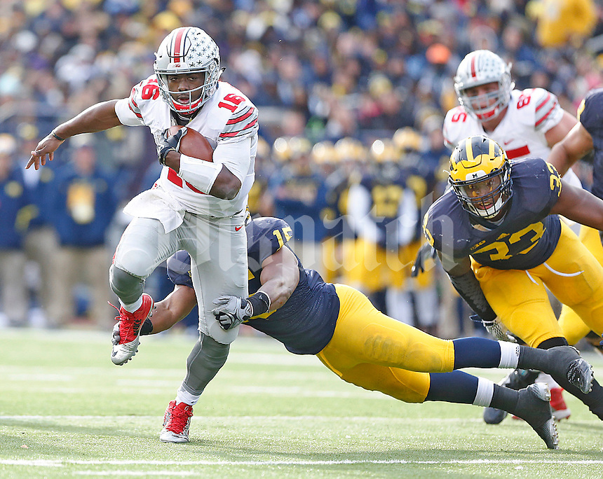 Ohio State Buckeyes quarterback J.T. Barrett (16) heads to the touchdown for a third quarter TD Michigan Stadium on November 28, 2015. (Chris Russell/Dispatch Photo)