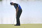 Padraig Harrington takes his putt on the par3 17th green during Day 2 of the Dubai World Championship, Earth Course, Jumeirah Golf Estates, Dubai, 26th November 2010..(Picture Eoin Clarke/www.golffile.ie)