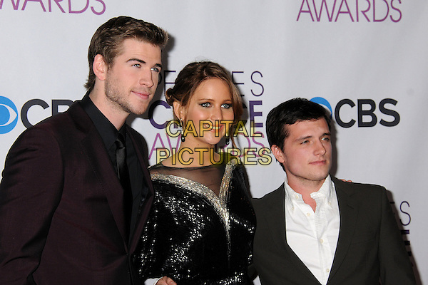 Liam Hemsworth, Jennifer Lawrence, Josh Hutcherson.People's Choice Awards 2013 - Press Room held at Nokia Theatre L.A. Live, Los Angeles, California, USA..January 9th, 2013.half length black gold sheer dress sparkly sequins sequined suit aubergine maroon grey gray shirt white.CAP/ADM/BP.©Byron Purvis/AdMedia/Capital Pictures.