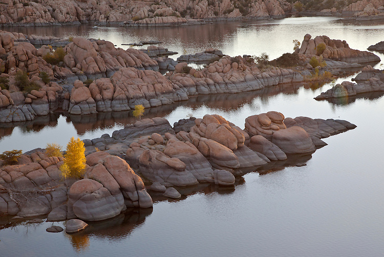 Granite rocks and golden cottonwoods (Populus fremontii) during autumn at Watson Lake, Arizona, USA