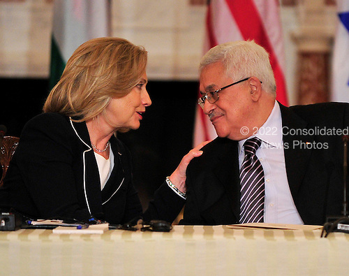 "United States Secretary of State Hillary Rodham Clinton shares some thoughts with President Mahmoud Abbas of the Palestinian Authority as she hosts the ""Relaunch of Direct Negotiations Between the Israelis and Palestinians"" in the Benjamin Franklin Room of the U.S. Department of State on Thursday, September 2, 2010.  .Credit: Ron Sachs / CNP.(RESTRICTION: NO New York or New Jersey Newspapers or newspapers within a 75 mile radius of New York City)"