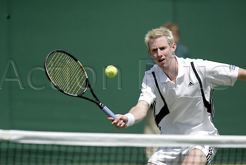 24 June 2004: British player JONATHAN MARRAY (GBR) plays a volley at the net during his 5 set first round singles defeat to Beck. Marray lost 4-6, 7-6, 6-4, 3-6, 8-10. Photo: Steve Bardens/Action plus.. .040624 player volleys