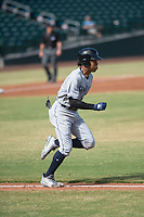 Peoria Javelinas left fielder Buddy Reed (85), of the San Diego Padres organization, runs to first base during an Arizona Fall League game against the Mesa Solar Sox at Sloan Park on October 24, 2018 in Mesa, Arizona. Mesa defeated Peoria 4-3. (Zachary Lucy/Four Seam Images)