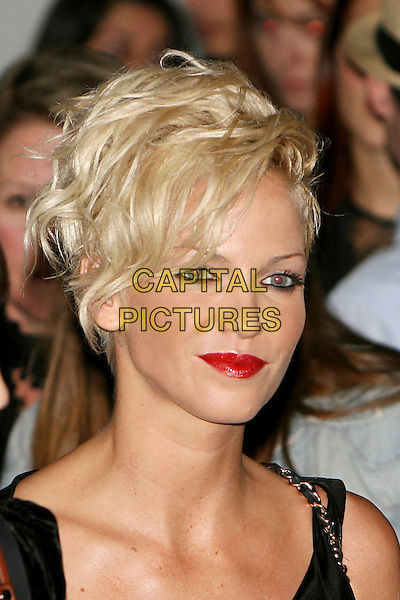SARAH HARDING (Girls Aloud).At the Vivienne Westwood Show, London Fashion Week Day 3, The Old Sorting Office, London, England, UK,.September 20th 2009..portrait headshot red lipstick eyeliner make-up .CAP/MAR.© Martin Harris/Capital Pictures.