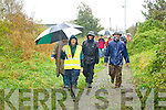 Joe Cotter leading the large group that walked on the Fenit walkway on Sunday.