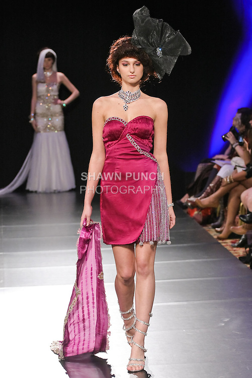 Model walks runway in an outfit from the Sushma Patel Fall 2011 collection, during Couture Fashion Week in New York Fall 2011.