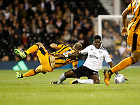 Sheyi Ojo of Fulham (on loan from Liverpool) is upended by David Meyler of Hull City during the Sky Bet Championship match between Fulham and Hull City at Craven Cottage, London, England on 13 September 2017. Photo by Carlton Myrie.
