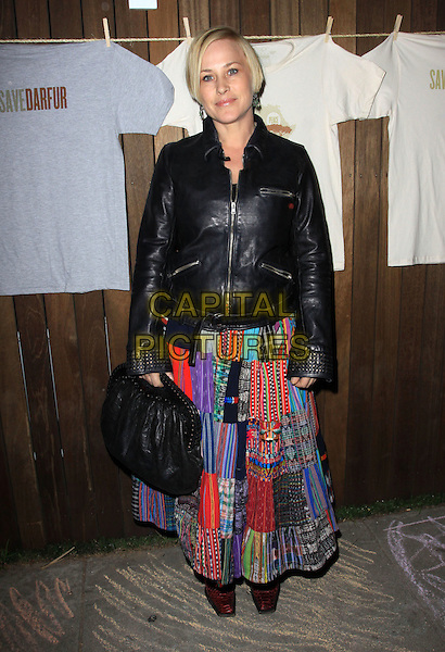 "PATRICIA ARQUETTE.Official Launch Party for ""Save Darfur Coalition and Propr held At The Propr Store & Jexy, Venice, California, USA..December 17th, 2009.full length black leather jacket skirt patches patchwork bag.CAP/ADM/KB.©Kevan Brooks/AdMedia/Capital Pictures."