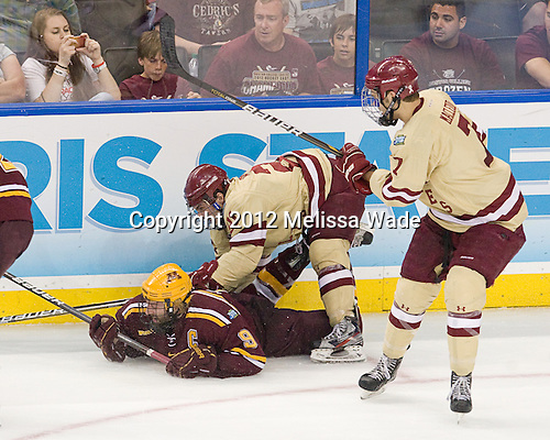 Taylor Matson (Minnesota - 9), Steven Whitney (BC - 21) - The Boston College Eagles defeated the University of Minnesota Golden Gophers 6-1 in their 2012 Frozen Four semi-final on Thursday, April 5, 2012, at the Tampa Bay Times Forum in Tampa, Florida.