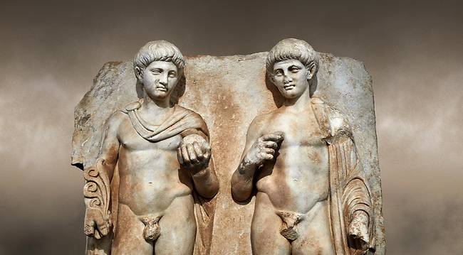 Close up of a Roman Sebasteion relief  sculpture of  Two princes, Aphrodisias Museum, Aphrodisias, Turkey. Against an art background.<br /> <br /> Two princes stand like statues, naked, wearing cloaks. The left figure holds the orb of the world in one hand, a symbol of  world rule that indicates he is the imperial heir, and in the other a ship's stern ornament (aphlaston), a symbol of naval victory. They and probably Gius and Lucius, the grandsons of Augustus, or Nero and Britanicus, Claudius' heir.