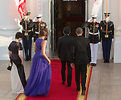 Akie Abe, first lady Michelle Obama, Prime Minister Shinzo Abe of Japan and United States President Barack Obama  walk into The White House in Washington DC for a State Dinner, April 28, 2015. <br /> Credit: Chris Kleponis / CNP