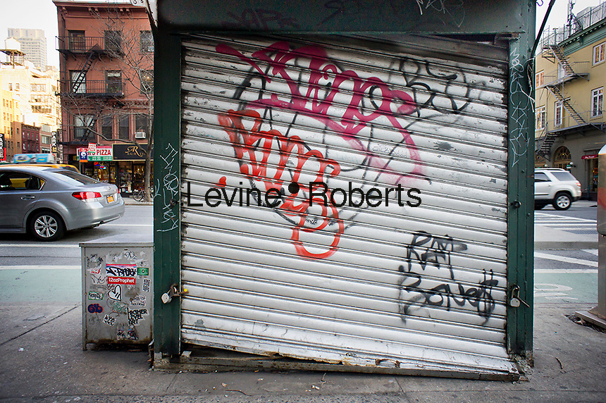 A graffiti covered closed newsstand in the Chelsea neighborhood of New York is seen on Saturday, January 28, 2012.  (© Richard B. Levine)