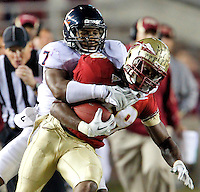 TALLAHASSEE, FL 11/19/11-FSU-UVA111911 CH-Florida State's Jermaine Thomas is thrown to the ground by Virginia's Corey Mosley during second half action Saturday at Doak Campbell Stadium in Tallahassee. The Seminoles lost to the Cavaliers 14-13..COLIN HACKLEY PHOTO