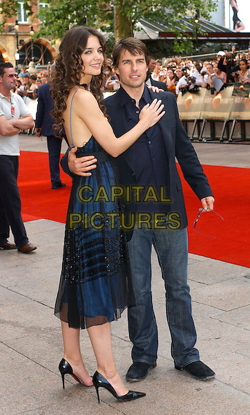 """KATIE HOLMES & TOM CRUISE.""""War of The Worlds"""" UK Premiere.June 19th, 2005.full length celebrity couple engaged arm around waist hand on chest blue sheer dress jeans denim.www.capitalpictures.com.sales@capitalpictures.com.© Capital Pictures."""