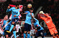 Mame Diouf of Stoke heads the ball towards goal during the EPL - Premier League match between Stoke City and Newcastle United at the Britannia Stadium, Stoke-on-Trent, England on 1 January 2018. Photo by Bradley Collyer / PRiME Media Images.