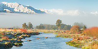 Waitangitaona River near Whataroa with Southern Alps in background after fresh morning snow, West Coast, South Westland, New Zealand