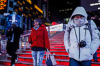 People visit Times Square as the temperatures are set a record low in New York. 15.02.2015. Kena Betancur/VIEWpress.