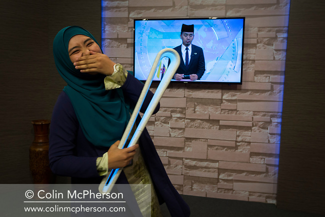 The Queen's Baton Relay spent its first full day of activities in Brunei during a four-day visit to the country. This Queen's Baton Relay will engage with all 70 nations and territories of the Commonwealth, over 388 days and cover 230,000km. It will be the longest Relay in Commonwealth Games history, finishing at the Opening Ceremony on the Gold Coast on 4th April 2018. Photograph shows a member of the production crew pictured with the Baton after a live nationwide television broadcast on Radio Televisyen Brunei featuring the QBR.