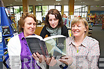 Marita Corcoran, Maria Doyle and Noreen O'Keeffe Staff at Kerry County Library in Tralee with the Bestselling book 50 Shades of Grey there is currently a couple of months waitlist.