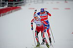 HOLMENKOLLEN, OSLO, NORWAY - March 16: (L-R) Petter Eliassen of Norway (NOR) and Alexander Legkov of Russia (RUS) during the Men 50 km mass start, free technique, at the FIS Cross Country World Cup on March 16, 2013 in Oslo, Norway. (Photo by Dirk Markgraf)