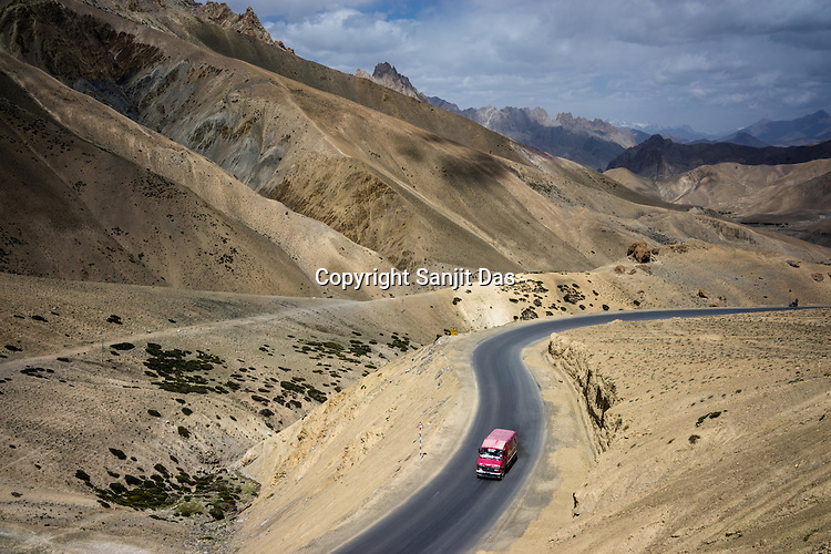 An Indian postal service truck driving on the Srinagar - Leh highway.