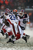 December 16th, 2007:  Buffalo Bills rookie quarterback Trent Edwards (5) hands off to fellow rookie Marshawn Lynch (23) vs the Cleveland Browns at Cleveland Browns Stadium in Cleveland, Ohio.  The Browns shutout the Bills 8-0 to inch closer to a playoff spot.  Photo copyright Mike Janes Photography 2007.