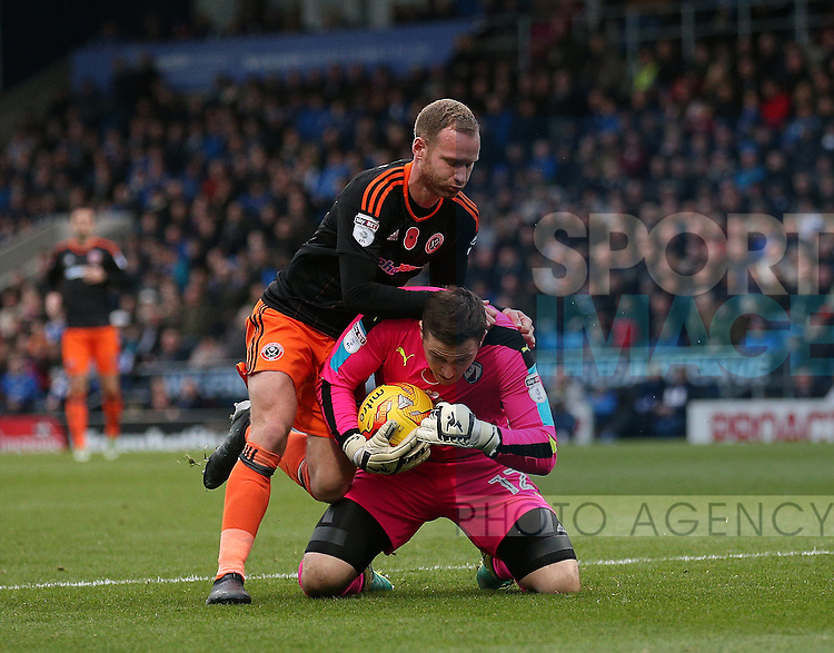 Matt Done of Sheffield Utd tussles with Ryan Fulton of Chesterfield during the English League One match at the Proact Stadium, Chesterfield. Picture date: November 13th, 2016. Pic Simon Bellis/Sportimage