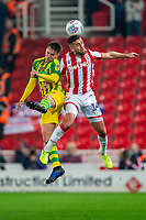 4th November 2019; Bet365 Stadium, Stoke, Staffordshire, England; English Championship Football, Stoke City versus West Bromwich Albion; Tommy Smith of Stoke City and Conor Townsend of West Bromwich Albion jump for the ball - Strictly Editorial Use Only. No use with unauthorized audio, video, data, fixture lists, club/league logos or 'live' services. Online in-match use limited to 120 images, no video emulation. No use in betting, games or single club/league/player publications