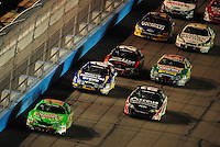 Apr 11, 2008; Avondale, AZ, USA; NASCAR Nationwide Series driver Kyle Busch (18) leads the field during the Bashas Supermarkets 200 at the Phoenix International Raceway. Mandatory Credit: Mark J. Rebilas-