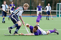 Will Naylor (L) of Hampstead is challenged by a Sevenoaks player during the England Hockey League Mens Semi-Final Cup game between Hampstead & Westminster and Sevenoaks at the Paddington Recreation Ground, Maida Vale on Sun March 21, 2010