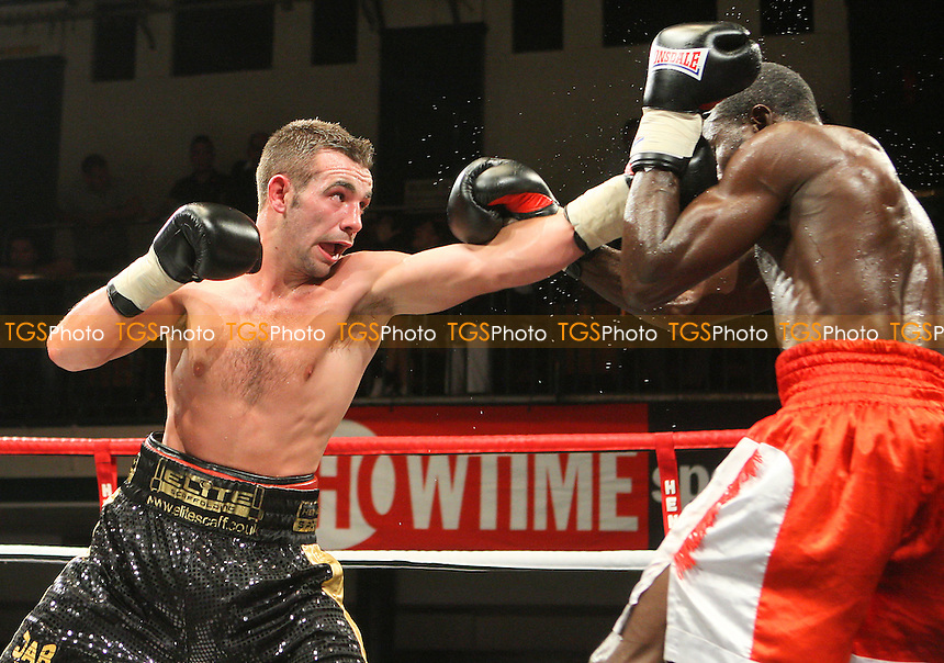 Lee Purdy (black/gold shorts) defeats Theophilus Tetteh in a Welterweight boxing contest at York Hall, Bethnal Green, promoted by Hennessy Sports / Shobox: The Next Generation - 10/09/10 - MANDATORY CREDIT: Gavin Ellis/TGSPHOTO - SELF-BILLING APPLIES WHERE APPROPRIATE. NO UNPAID USE. TEL: 0845 094 6026