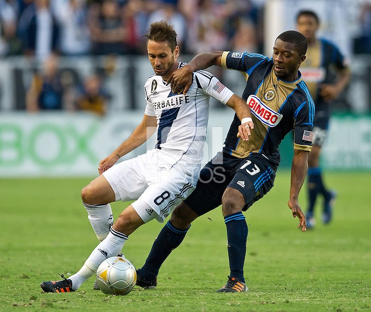 CARSON, CA - July 4, 2012: LA Galaxy midfielder Marcelo Sarvas (8) and Philadelphia Union midfielder Michael Lahoud (13) during the LA Galaxy vs Philadelphia Union match at the Home Depot Center in Carson, California. Final score LA Galaxy 1, Philadelphia Union 2.