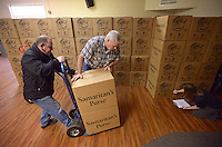 NWA Democrat-Gazette/BEN GOFF @NWABENGOFF<br /> Tony Pedone (from left) of Rogers, Michael Cain of Gentry and Ginny Harper of Pea Ridge stack and inventory boxes arriving from First Baptist Church in Centerton on Thursday Nov. 19, 2015 while volunteering at the Operation Christmas Child Northwest Arkansas Collection Center at Calvary Chapel in the Ozarks in Rogers. Operation Christmas Child shoe boxes collected from relay centers at area churches are crated and brought to the collection center where they will be shipped to Denver, Colo. for processing and distribution.