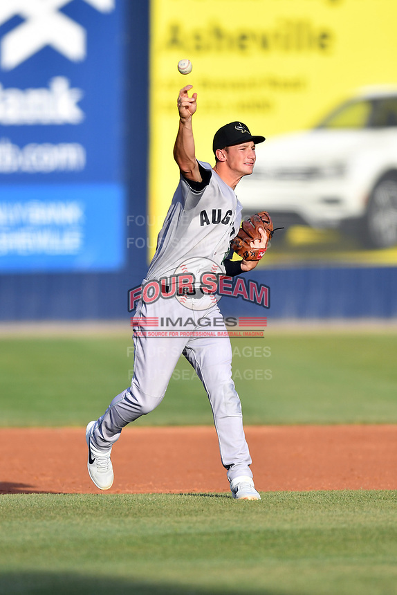 Augusta GreenJackets third baseman Jacob Gonzalez (18) throws to first base during a game against the Asheville Tourists at McCormick Field on April 6, 2019 in Asheville, North Carolina. The Tourists defeated the GreenJackets 6-3. (Tony Farlow/Four Seam Images)